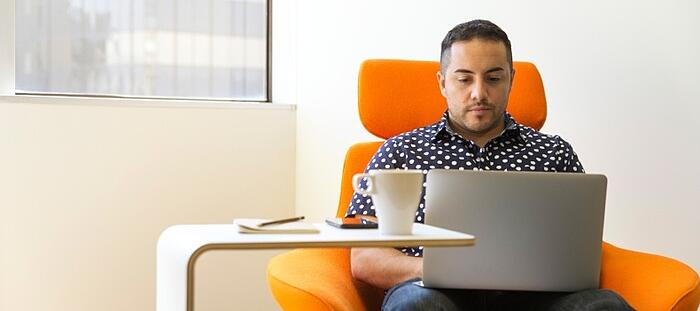 Man on laptop looking for b2b sales tips